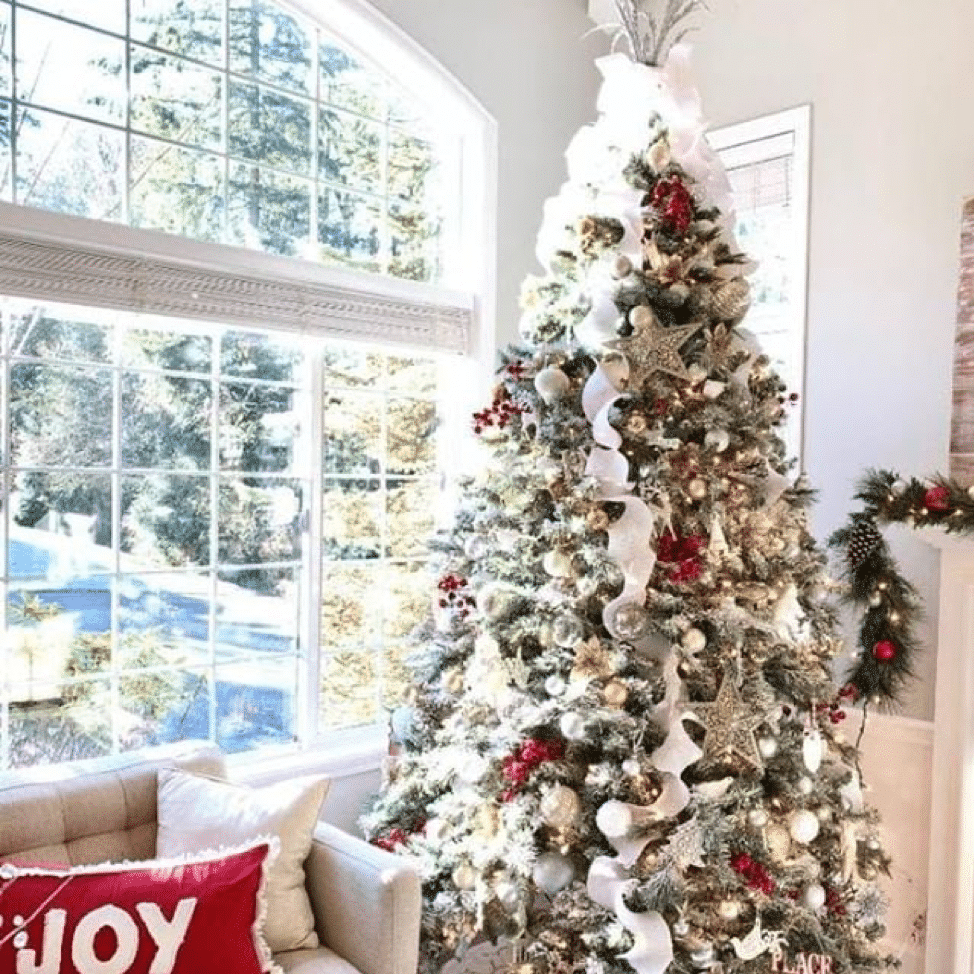 Christmas Tree with white trimmings and gold decor.
